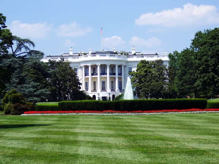 A large green field in front of White House