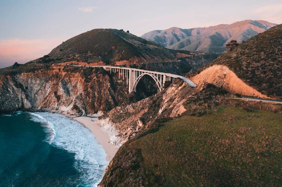 Bixby Creek Bridge with a mountain in the background