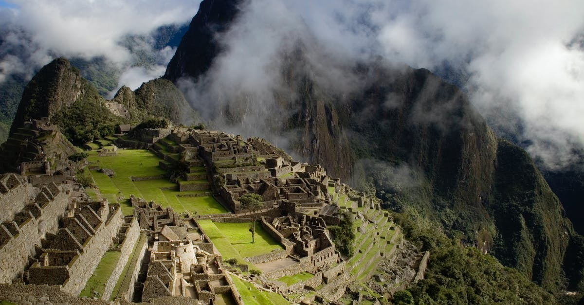 A steam train is on the side of Machu Picchu